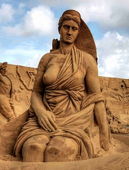 statue of artemis, a breast starred, in the sand
