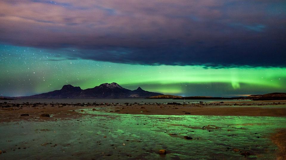 Scandinavian landscape under aurora borealis